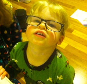 Six days after diagnosis in his papa's glasses.